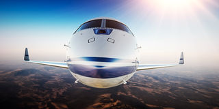 Closeup Photo of White Luxury Generic Design Private Aircraft Flying in Blue Sky.Uninhabited Desert Mountains Sun Stock Photography