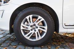 Closeup photo of white modern car wheel Stock Images