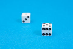 Closeup photo of white standard dices. Royalty Free Stock Photography