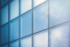 Closeup photo window of modern skyscraper business district in day light. Blue Skyscraper facade, office buildings Royalty Free Stock Photos