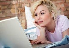 Closeup photo of woman with laptop Stock Photo