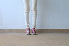 Closeup Photo of From Woman Wearing Red Sneakers On The Concrete Floor Background. Great For Any Use Royalty Free Stock Photography