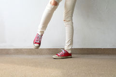 Closeup Photo of From Woman Wearing Red Sneakers On The Concrete Floor Background. Great For Any Use Stock Images
