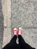 Closeup Photo of From Woman Wearing Red Sneakers On The Concrete Floor Background. Great For Any Use Stock Photo