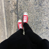 Closeup Photo of From Woman Wearing Red Sneakers On The Concrete Floor Background. Great For Any Use Royalty Free Stock Photos