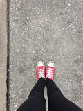 Closeup Photo of From Woman Wearing Red Sneakers On The Concrete Floor Background. Great For Any Use Royalty Free Stock Photo