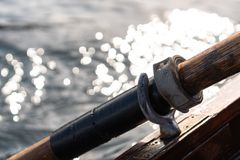 Closeup photo of wooden paddle attached to boat used for rowing in the water, lake Bled on a sunny day. Closeup photo of wooden paddle used for rowing in the royalty free stock photography