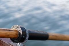 Closeup photo of wooden paddle attached to boat used for rowing in the water, lake Bled on a sunny day stock photos