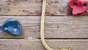 Closeup image of wooden wall with rope for climbing royalty free stock photography