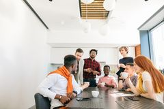 Closeup photo of young business team having conversation in. The modern dining room stock photos