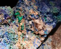 Closeup photograph of malachite and azurite mineral s. Colorful closeup photograph of malachite and azurite minerals. With small part of black background stock images
