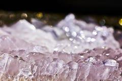 Closeup photograph of transparent calcite mineral crystal. Closeup photograph of glittering transparent calcite mineral crystal with reddish details and very Stock Photo