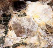 Closeup photograph of two mica pegmatite mineral stock photo