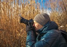 Closeup of photographer with digital camera outdoors. Royalty Free Stock Images