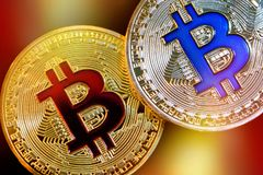 Physical version of Bitcoin new virtual money with colorful effect. Closeup on Physical version of Bitcoin new virtual money with colorful effect Royalty Free Stock Photography