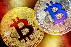 Physical version of Bitcoin new virtual money with colorful effect. Closeup on Physical version of Bitcoin new virtual money with colorful effect Royalty Free Stock Images