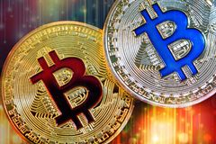 Physical version of Bitcoin new virtual money with colorful effect. Closeup on Physical version of Bitcoin new virtual money with colorful effect Stock Image