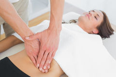 Closeup of a physiotherapist massaging womans body Royalty Free Stock Images