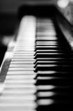 Closeup on Piano. In Black and White, selective focus on keys. Dark background royalty free stock photography
