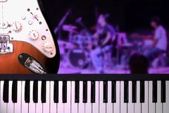 Closeup on piano and guitar with on stage concert. stock image