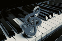 Closeup Piano keys. Silver treble clef is on extreme closeup piano keys Stock Photo