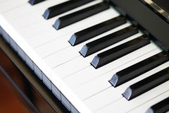Closeup of piano keys of black piano Stock Images