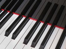 Closeup of piano keys, close frontal view Stock Photography