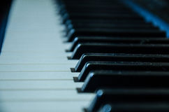 Closeup of a piano keys with selective focus. Close frontal view of piano keys Royalty Free Stock Images