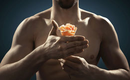Closeup picture of athlete holding a flower Stock Photos