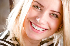 Closeup picture of beautiful blond young woman having fun happy smiling showing great dental whitening teeth Stock Photos