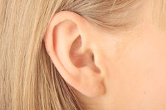 Closeup picture of blond girl ear Stock Photography