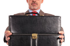 Closeup picture of a businessman holding a briefcase Royalty Free Stock Photo