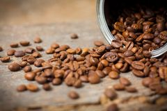 Closeup picture of can with coffee. Close up of coffee beans in can stock images