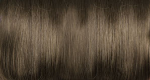 Closeup picture of dark, dense, straight coiffure Stock Images