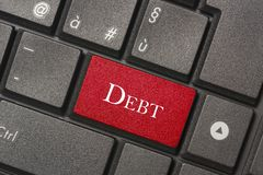 Closeup picture of Debt button of a modern keyboard royalty free stock photo