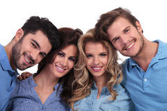 Closeup picture of four casual young people smiling Royalty Free Stock Photos