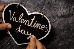 Hand writing Valentine day in chalkboard royalty free stock images