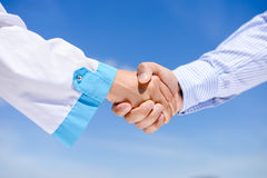 Closeup picture of handshake between a man and a Stock Photo