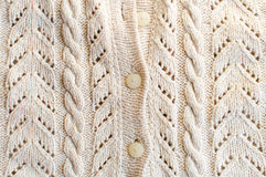 Closeup picture of knitted fabric with white buttons Royalty Free Stock Image