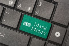 Closeup picture of Make Money button of keyboard of a modern computer stock photography