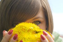Closeup Picture Of Woman Eyes Behind Yellow Flower Stock Image