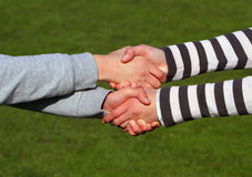 Closeup picture of shaking hands. Stock Photos