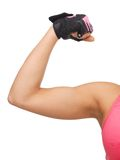 Sporty woman flexing her biceps Royalty Free Stock Photo