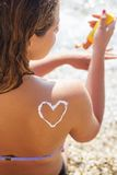 Closeup picture of sunscreen spf filtred tan Royalty Free Stock Images