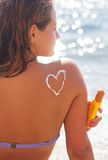 Closeup picture of sunscreen tan lotion on woman Royalty Free Stock Photos