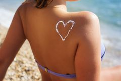 Closeup picture of sunscreen tan lotion on woman Stock Images