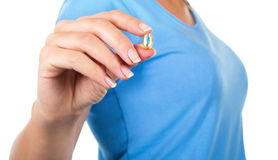 Closeup picture of woman with Omega 3 fish oil capsule Royalty Free Stock Image