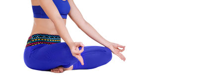 closeup picture of a yoga girl sitting on the floor Stock Photo