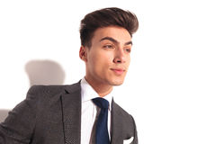 Closeup picture of a young business man looking to side Stock Photography