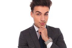 Closeup picture of a young business man thinking Stock Photography